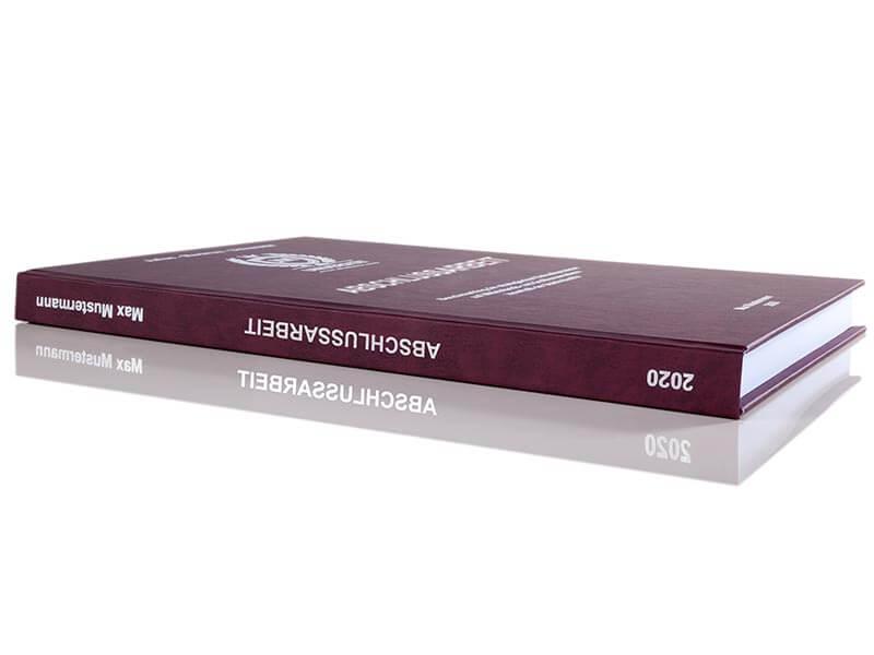 Premium Hardcover-Bindung bordeauxrot Buchrücken-Perspektive